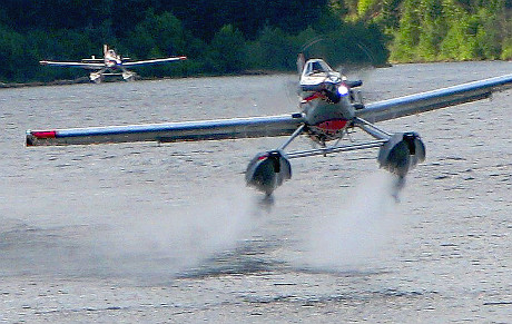 two waterbombers coming in for water